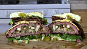 SmokingPit.com - The Colossal Trinity BBQ Surf & Turf burger - stuffed burger cooked over a oak wood fire on the Yoder YS640 Pellet cooker.- The money shot.