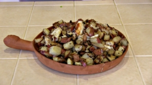 SmokingPit.com - Dungeness crab meat, bacon, garlic, green onion, gree pepper and postatoes fried with Creole seasoning. Yum!