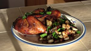 SmokingPit.com - Super moist Orange Chicken with Garlic Red Potatoes cooked on a Scottsdale Santa Maria style cooker over an Oak wood fire. The Scottsdale by Arizona BBQ Outfitters. - The money shot!