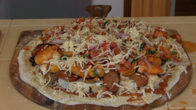SmokingPit.com - Cajun Seafood Pizza recipe wood fire cooked on my Scottsdale Santa Maria style cooker. The built pizza.