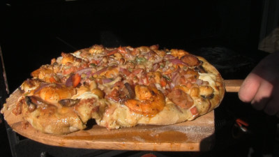 SmokingPit.com - Cajun Seafood Pizza recipe wood fire cooked on my Scottsdale Santa Maria style cooker. Hot off the cooker.