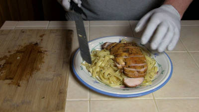 SmokigPit.com - Chicken Fettuccine Marsala Recipe - slow cooked on a Yoder YS640 Pellet smoker. -  slicing the chicken.