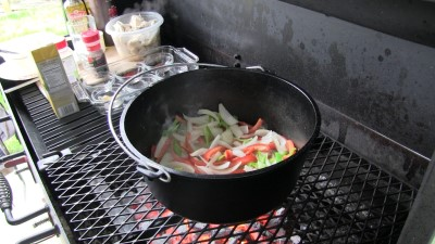 "SmokingPit.com - Dutch oven Arroz Con Pollo cooked in a Lodge 12"" dutch oven in my Scottsdale Santa Maria style cooker. Cooking the veggies."