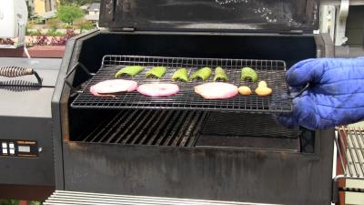 SmokingPit.com - Seared Tatonka Dust coated Buffalo Burgers  - Yoder YS640 cooked BBQ recipes & smoking meat tips and techniques. Roasting peppers.