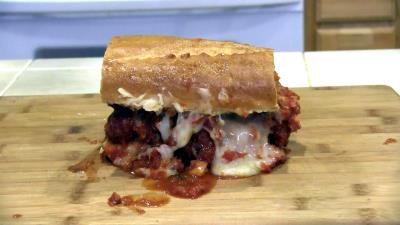SmokingPit.com BBQ - Signature Apple Smoked Meatball Sub with a fresh tangy marinara. The money shot.