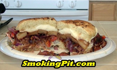 SmokingPit.com - The Ultimate Smoked BBQ Pulled Pork Sandwich sliced to show ingredients - Smoked on a Yoder YS640 -