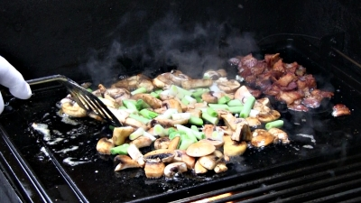 SmokingPit.com - Cajun Shrimp & Bay Scallops with a cajun butter sauce and mushrooms. Griddle cooked on a Yoder YS640 Pellet grill.Saute the veggies.